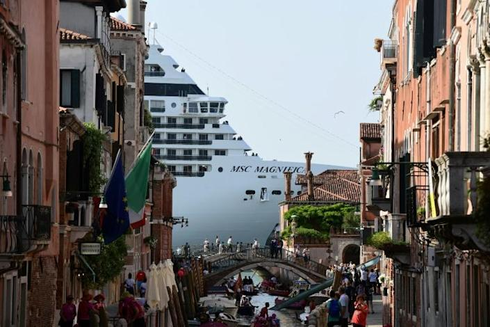 The latest cruise ships tower over Venice (AFP Photo/Miguel MEDINA)
