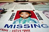The photographs of missing Indian children are displayed at a police station in New Delhi. According to recent crime statistics, 14 children go missing in New Delhi every day, at least six of whom are victims of human trafficking