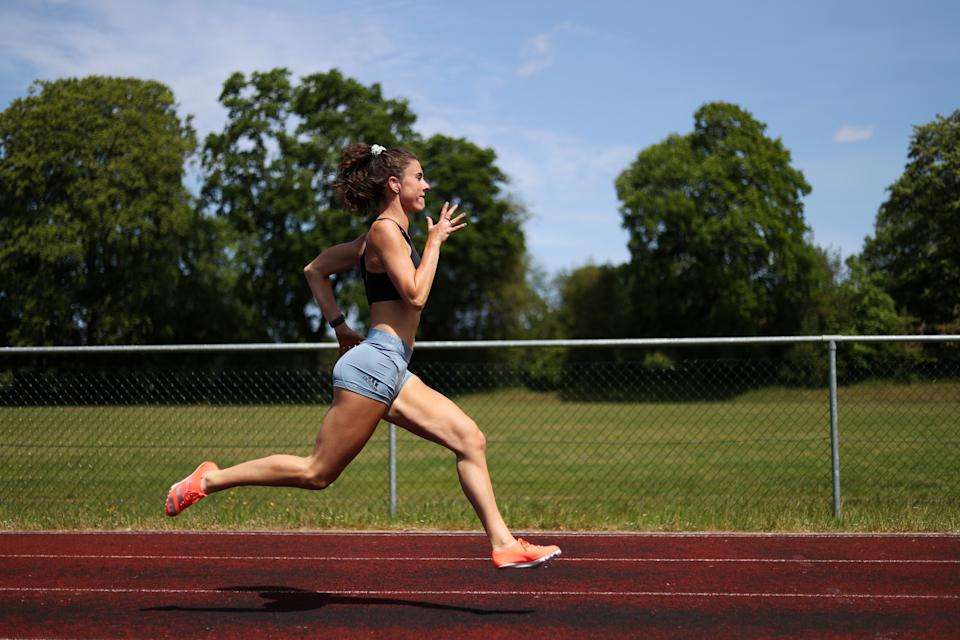 LIPHOOK, ENGLAND - MAY 22: Paralympian Olivia Breen of Great Britain continues to train in isolation at a local running track near to her Family home in Liphook on May 22, 2020 in Liphook, England. The coronavirus and the disease it causes, COVID-19, are having a fundamental impact on society, government, sports and the economy in United Kingdom. As all sports events in United Kingdom have been cancelled athletes struggle to continue their training as usual. (Photo by Naomi Baker/Getty Images)