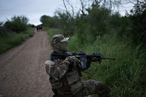 PHOTO: A member of the U.S. Border Patrol Tactical Unit, known as BORTAC, lifts his weapon in response to sounds of gunshots near where a family illegally crossed the Rio Grande river into the United States from Mexico, in Fronton, Texas, Oct. 18, 2018. (Adrees Latif/Reuters)