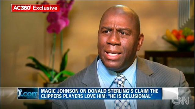 "In this image taken from video provided by CNN, Magic Johnson talks with host Anderson Cooper at studios in Los Angeles in an interview broadcast Tuesday, May 13, 2014. Johnson says Los Angeles Clippers owner Donald Sterling is ""living in the stone ages"" in his attitudes about minorities, and was shocked such a prominent man would have such ignorant views on HIV and AIDS. Sterling made his first public comments Monday since racist recordings emerged last month and earned him a lifetime NBA ban. (AP Photo/CNN)"