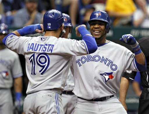 Toronto Blue Jays' Edwin Encarnacion, right, flexes with Jose Bautista after Encarnacion hit a home run off Tampa Bay Rays relief pitcher Joel Peralta during the eighth inning of a baseball game, Wednesday, May 23, 2012, in St. Petersburg, Fla. (AP Photo/Chris O'Meara)