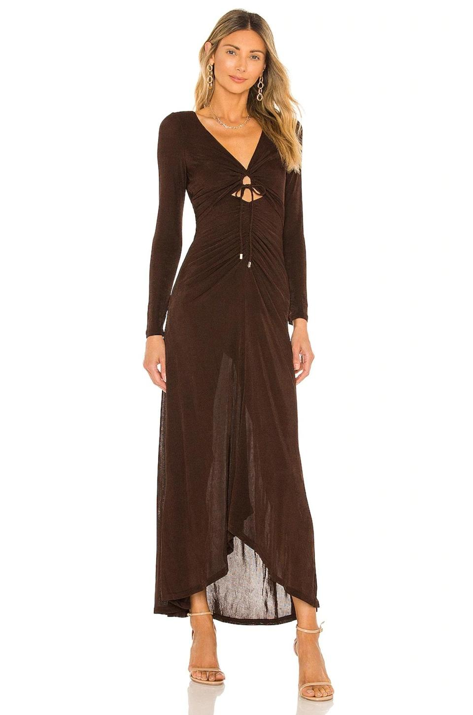 """A long-sleeve dress, like this style from Significant Other, will be the one you reach for over and over again. The <a href=""""https://www.glamour.com/gallery/brown-neutral-trend?mbid=synd_yahoo_rss"""" rel=""""nofollow noopener"""" target=""""_blank"""" data-ylk=""""slk:chocolate brown"""" class=""""link rapid-noclick-resp"""">chocolate brown</a> hue—and peekaboo detail—keep things on-trend for 2021. $200, Revolve. <a href=""""https://www.revolve.com/significant-other-neave-dress/dp/SIGR-WD39/"""" rel=""""nofollow noopener"""" target=""""_blank"""" data-ylk=""""slk:Get it now!"""" class=""""link rapid-noclick-resp"""">Get it now!</a>"""