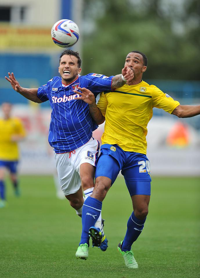 Carlisle United's Paul Black and Coventry City's Callum Wilson battle for the ball during the Sky Bet Football League One match at Brunton Park, Carlisle.