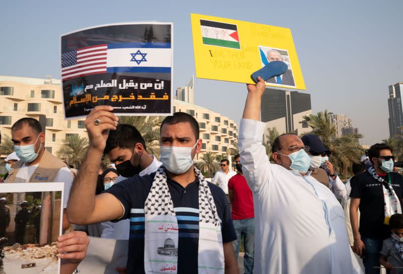 People gather during a protest to express solidarity with the Palestinian people amid a flare-up of Israeli-Palestinian violence