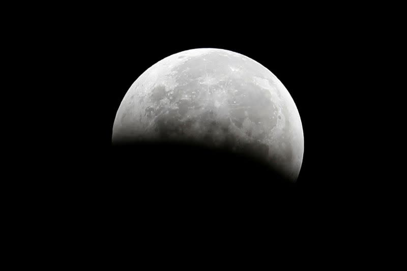 "FILE PHOTO: A total lunar eclipse, also known as a ""blood moon"", is pictured from Santa Monica"