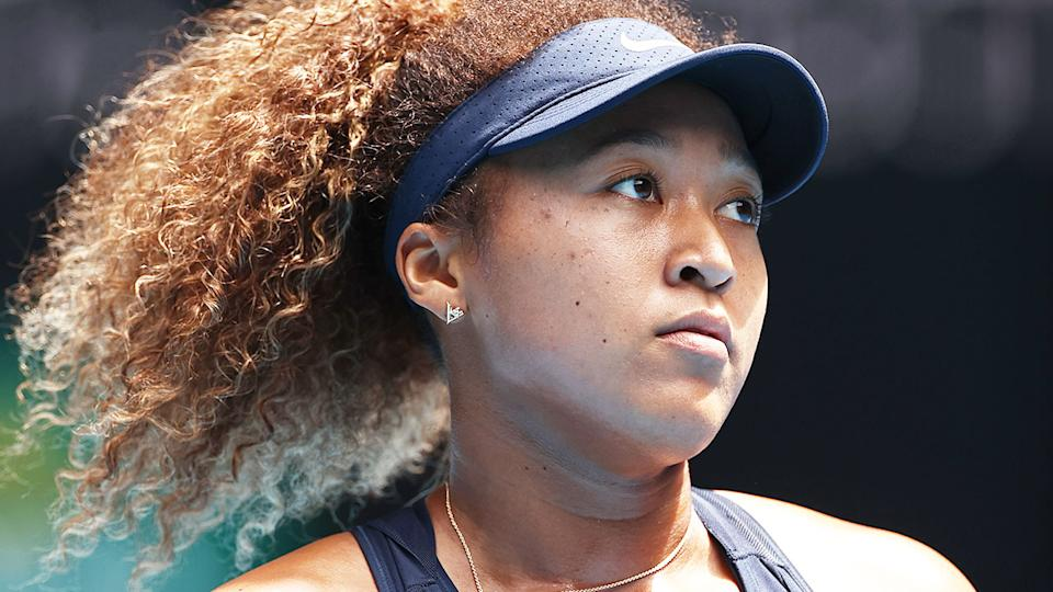 Pictured here, Naomi Osaka looks sad during a tennis match.