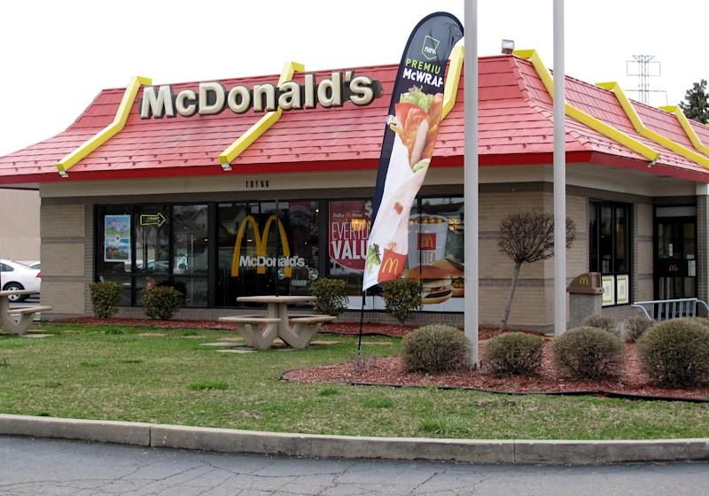 A McDonald's restaurant in Dearborn, Mich., involved in a suit over non-halal food is seen on Tuesday, April 16, 2013.  A judge on Wednesday finalized a $700,000 settlement between McDonald's Corp., the franchise owner of the Dearborn restaurant, and members of Michigan's Muslim community over claims the suburban Detroit restaurant falsely advertised its food as prepared according to Islamic law. (AP Photo/Jeff Karoub)