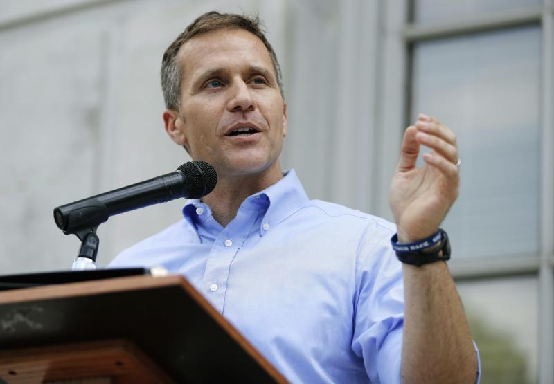 FILE- In this May 23, 2017, file photo, Missouri Gov. Eric Greitens speaks outside the state Capitol in Jefferson City, Mo. It didn't take long after Greitens was indicted for alleged invasion of privacy for Missouri Democrats to tie him to Attorney General Josh Hawley, the presumed GOP front runner in Missouri's hotly contested U.S. Senate race. Nor did it take long for Republicans to link the prosecutor who announced the charges to a prominent national Democratic financier.(AP Photo/Jeff Roberson, File)