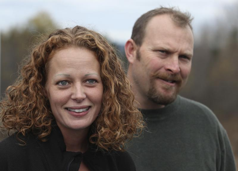 "Nurse Kaci Hickox (L) joined by her boyfriend Ted Wilbur, speaks with the media outside of their home in Fort Kent, Maine in this October 31, 2014 file photo. Hickox, who challenged quarantines of health care workers returning from treating West African Ebola patients said November 2, 2014 she thought ""an abundance of politics"" lurked behind them. REUTERS/Joel Page (UNITED STATES - Tags: HEALTH POLITICS)"