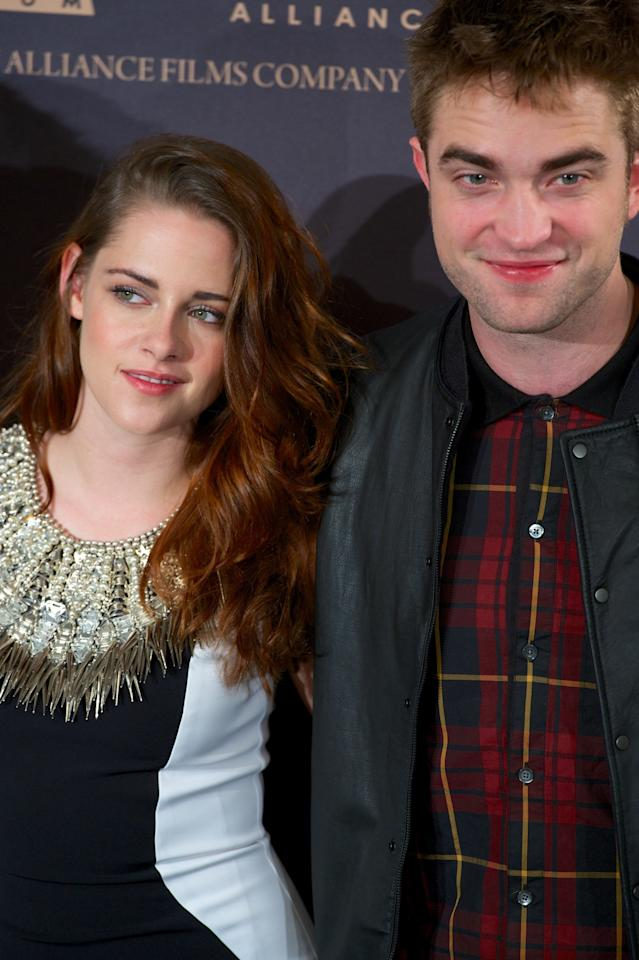 "MADRID, SPAIN - NOVEMBER 15:  Actress Kristen Stewart and actor Robert Pattinson attend the ""The Twilight Saga: Breaking Dawn - Part 2"" (La Saga Crepusculo: Amanecer Parte 2) photocall at the Villamagna Hotel on November 15, 2012 in Madrid, Spain.  (Photo by Carlos Alvarez/Getty Images)"
