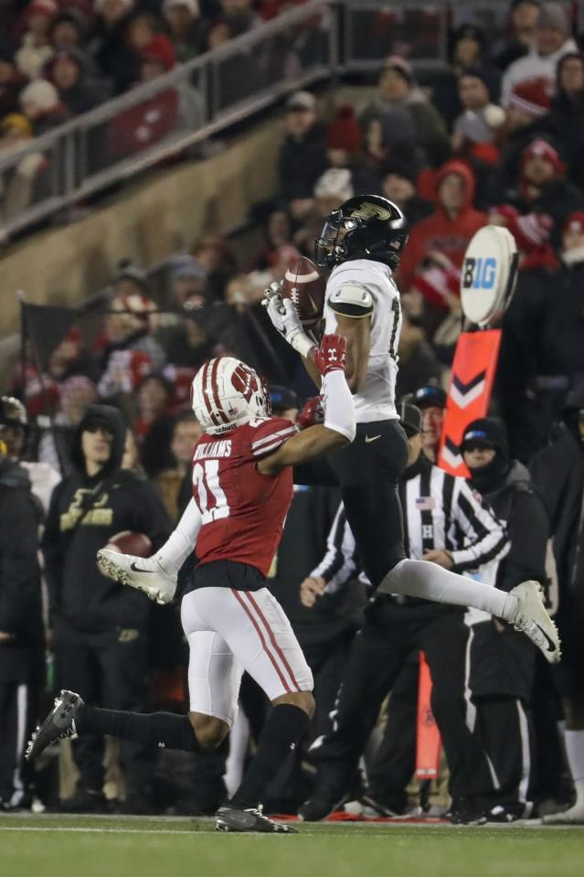 Purdue's Byron Perkins catches a pass in front of Wisconsin's Caesar Williams during the second half of an NCAA college football game Saturday, Nov. 23, 2019, in Madison, Wis. (AP Photo/Morry Gash)