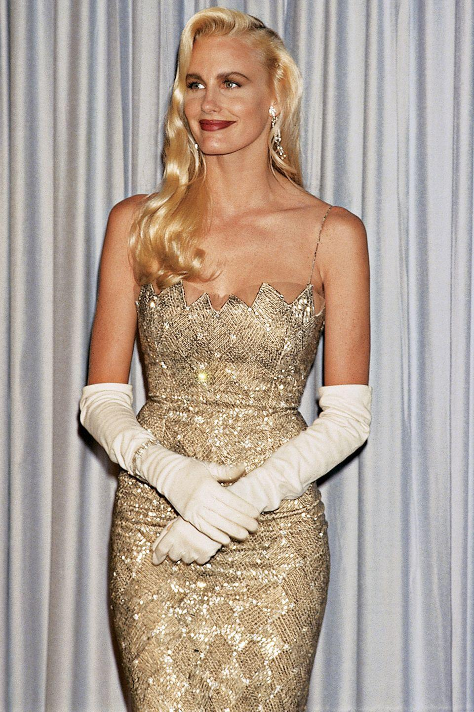 <p>While the popularity of elbow-length gloves was waning, they made even more of a statement when Daryl Hannah paired them with her glamorous gold dress and long blonde waves. </p>