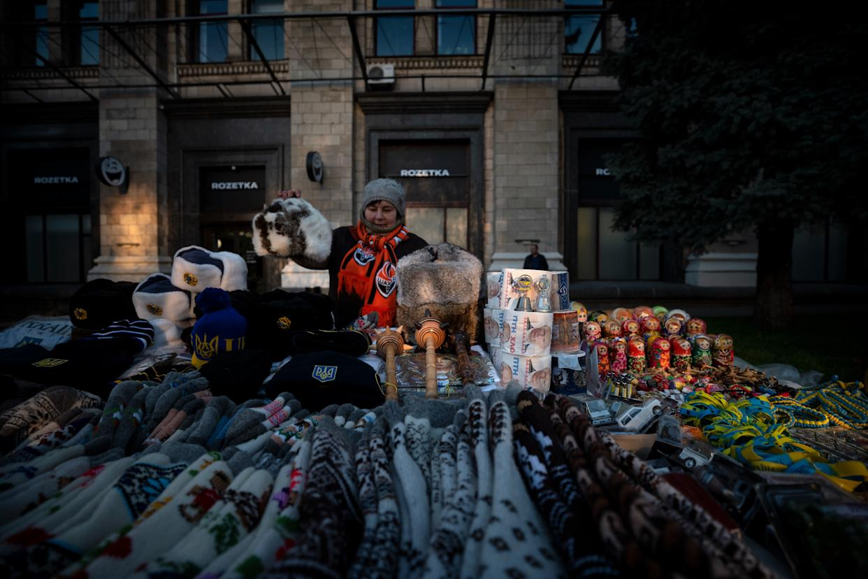 A street vendor arranges her stall with various items, among them a toilet paper with Russian president Putin's portrait on October 30, 2019. (Photo: Agron Dragaj for Yahoo News)