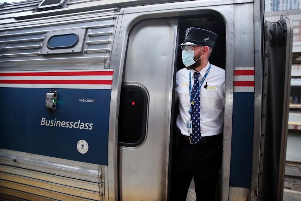 BOSTON, MA - JUNE 9: Amtrak assistant conductor James Spina looks over an empty platform while departing South Station in Boston, MA on on June 09, 2020. (Photo by Craig F. Walker/The Boston Globe via Getty Images)