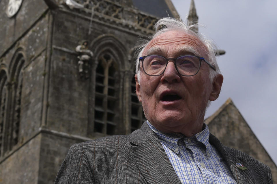 Henri-Jean Renaud, 86, poses outside the church in Sainte-Mere-Eglise, Normandy, Friday, June 4, 2021. Henri-Jean Renaud, 86, remembers D-Day like it was yesterday. He was a young boy and was hidden in his family home in Sainte-Mere-Eglise when more than 800 planes bringing U.S. paratroopers flew over the town while German soldiers machine guns were firing at them. (AP Photo/Nicolas Garriga)