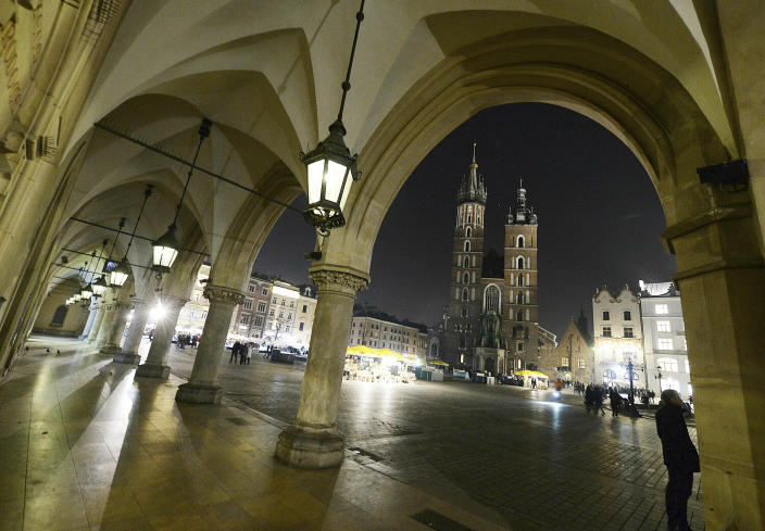 FILE - In this file photo taken on March 30, 2019, St. Mary's Basilica in the market square in Krakow, Poland. Every hour, a trumpeter plays the city's trademark bugle call from the taller tower. Officials said Thursday, May 6, 2021, that the team of trumpeters, who are retired firefighters, was recently reinforced with two new players.(AP Photo/Czarek Sokolowski)