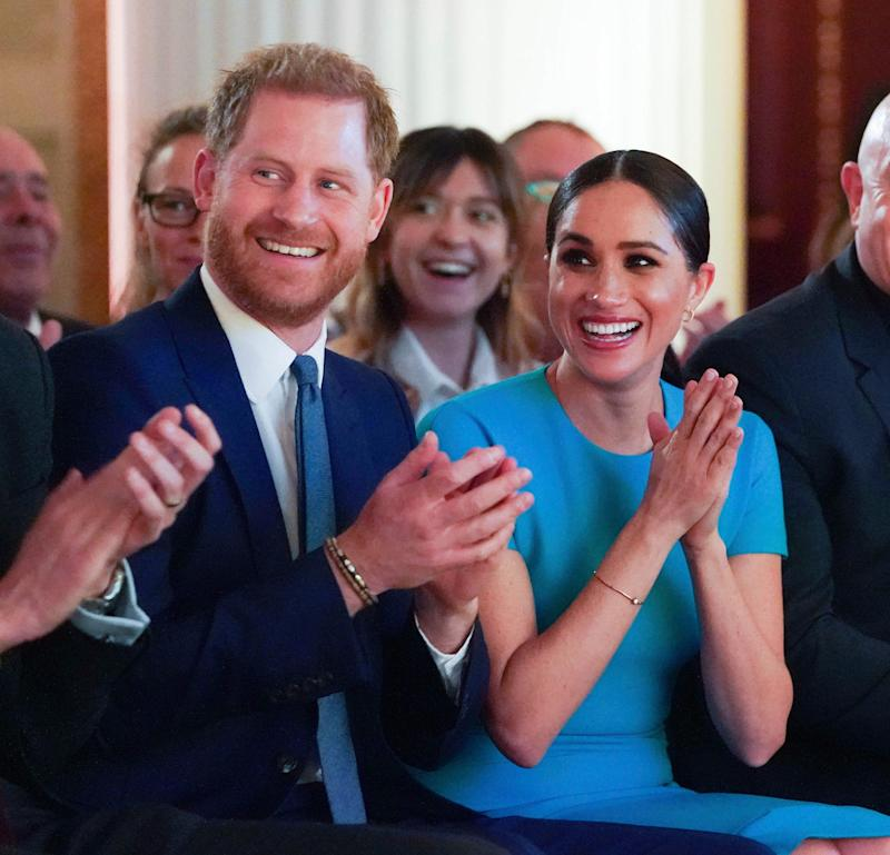 Britain's Prince Harry and Meghan, the Duchess of Sussex, cheer during a marriage proposal at the Endeavour Fund Awards at Mansion House in London, Thursday, March 5.