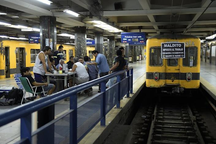 Workers of the subway gather in Plaza Constitucion station in Buenos Aires during a strike in Argentina on March 31, 2014 (AFP Photo/Juan Mabromata)