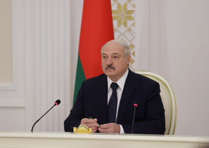 FILE PHOTO: Belarusian President Lukashenko chairs a meeting in Minsk