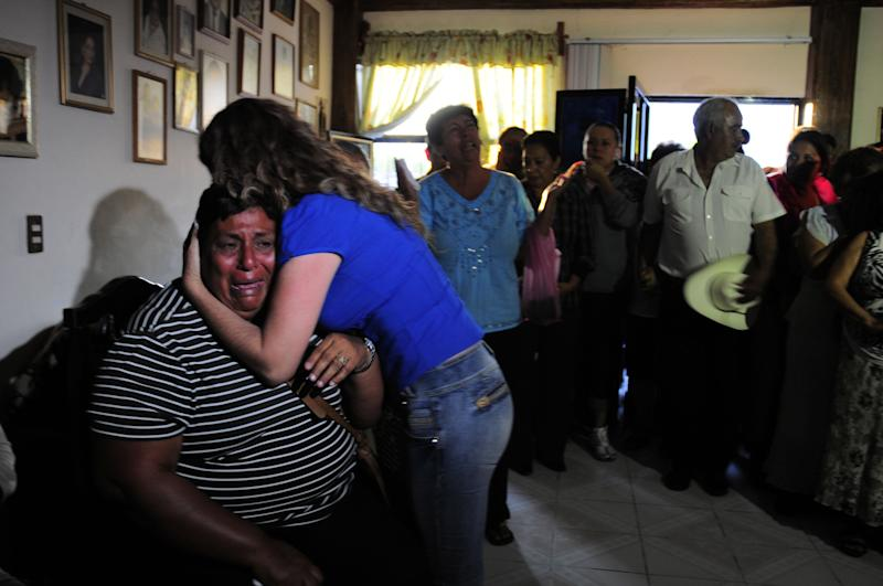 """Edelmira Arias is comforted while weeping at the home of the parents of Texas death-row inmate Edgar Tamayo, her cousin, in Miacatlan, Mexico, Wednesday, Jan. 22, 2014. The U.S. Supreme Court rejected appeals Wednesday night for Mexican national Edgar Tamayo, clearing the way for the Texas death row inmate to be executed for the slaying of a Houston police officer 20 years ago. Secretary of State John Kerry previously asked Texas to delay Tamayo's punishment, saying it """"could impact the way American citizens are treated in other countries."""" The State Department repeated that stance Wednesday. (AP Photo/Tony Rivera)"""
