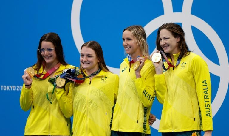 """""""The whole team has done an amazing job, and I'm just wanting to be part of that team,"""" says a humble Emma McKeon (2R) alongside Kaylee McKeown (L), Chelsea Hodges (2L) and Cate Campbell"""