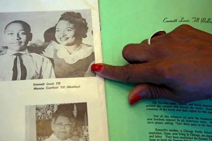 Deborah Watts of Minneapolis, points out a widely seen 1950s photograph of her cousin Emmett Till and his mother Mamie Till Mobley, during a visit to Jackson, Miss., Thursday, Aug. 27, 2015.