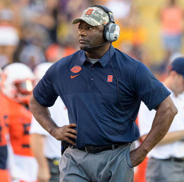 FILE - In this Sept. 23, 2017, file photo, Syracuse head coach Dino Babers walks the sidelines during an NCAA college football game against LSU in Baton Rouge, La. Barbers has five quarterbacks on the roster for the 2018 season, and says that he likes them all. (AP Photo/Matthew Hinton, File)