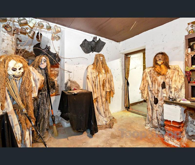 Halloween-esque mannequins and decorations at the Macgill 'creepy' house for sale. (Image: realestate.com.au/Toop & Toop)