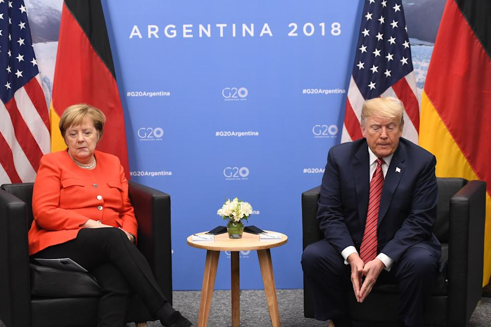 Germanys Chancellor Angela Merkel (L) and US President Donald Trump hold a bilateral meeting, on the sidelines of the G20 Leaders' Summit in Buenos Aires, on December 01, 2018. - The leaders of countries representing four-fifths of the global economy opened a two-day meeting in Argentina facing the deepest fractures since the first G20 summit convened 10 years ago in the throes of financial crisis. (Photo by SAUL LOEB / AFP)        (Photo credit should read SAUL LOEB/AFP/Getty Images)