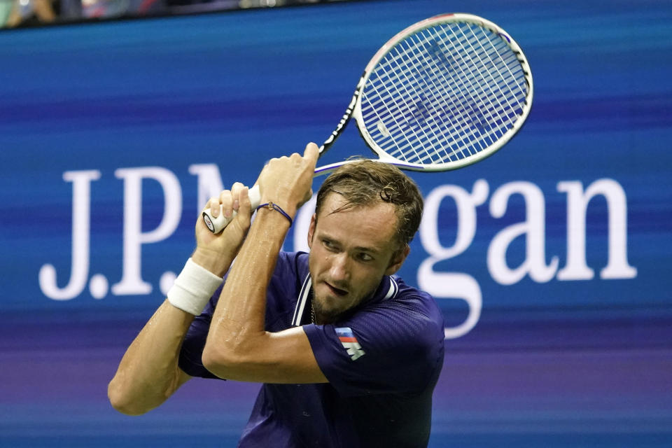 Daniil Medvedev, of Russia, returns a shot against Richard Gasquet, of France, during the first round of the US Open tennis championships, Monday, Aug. 30, 2021, in New York. (AP Photo/Elise Amendola)