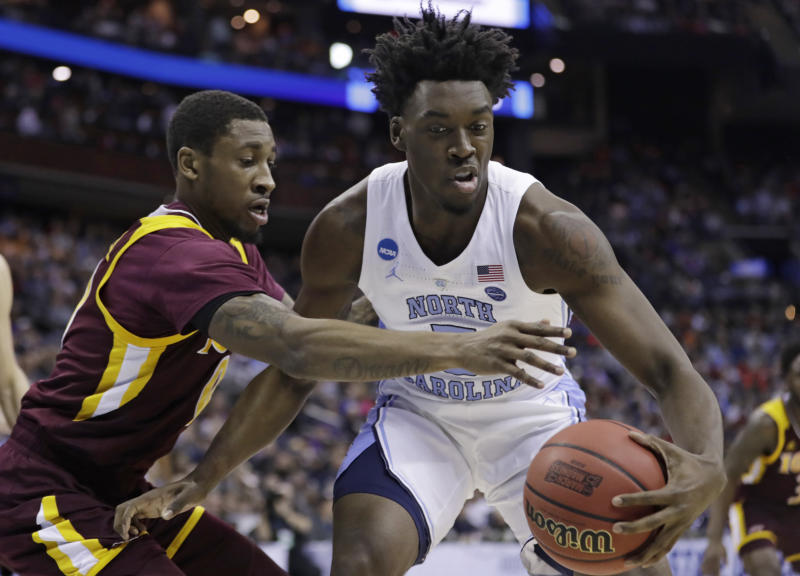 North Carolina's Nassir Little, right, drives past Iona's Rickey McGill in the first half during a first round men's college basketball game in the NCAA Tournament in Columbus, Ohio, Friday, March 22, 2019. (AP Photo/Tony Dejak)