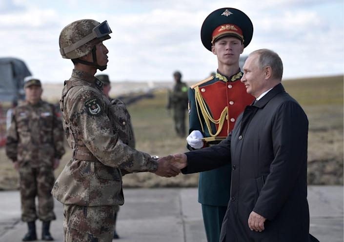 Russian President Vladimir Putin with Chinese soldier