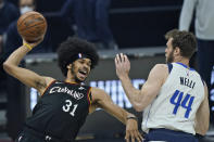 Cleveland Cavaliers' Jarrett Allen (31) tries to pass the ball against Dallas Mavericks' Nicolo Melli (44) in the first half of an NBA basketball game, Sunday, May 9, 2021, in Cleveland. (AP Photo/Tony Dejak)