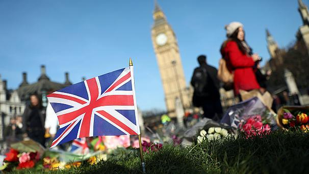 "As police slowly piece together the background of London attacker Khalid Masood, they continue to investigate whether he may have been acting on someone else's orders.   Six out of ten people taken in for questioning over the car ramming and knife attack near parliament have been released.    Four people, including a police officer, were killed and Masood was shot dead by officers.   In the city of Birmingham, where Masood recently lived, a vigil has been held for the victims.    Salma Yaqoob, an activist and former Birmingham City Councillor, said: ""Some extremists will try to exploit the situation, whether it's religious extremists like ISIS who claim attacks like this and want to project a stronger image of themselves, to glamorise themselves, to recruit more people to their evil aims; or far-right extremists who exploit such awful tragic incidents to stoke hatred against whole communities.""   Two of the more than 50 people injured in the attacks are still in a critical condition, with one reported to have life-threatening injuries."