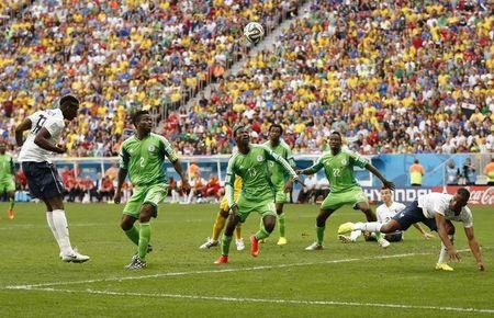 France's Paul Pogba scores a goal during their 2014 World Cup round of 16 game against Nigeria at the Brasilia national stadium in Brasilia