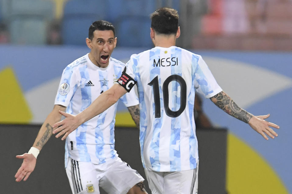 TOPSHOT - Argentina's Lionel Messi (R) celebrates with Argentina's Angel Di Maria after scoring against Ecuador during their Conmebol 2021 Copa America football tournament quarter-final match at the Olympic Stadium in Goiania, Brazil, on July 3, 2021. (Photo by DOUGLAS MAGNO / AFP) (Photo by DOUGLAS MAGNO/AFP via Getty Images)