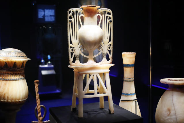 A calcite unguent vase with papyrus and lotus flower design is displayed as part of 'Tutankhamun, the treasure of the Pharaoh', an exhibition in partnership with the Grand Egyptian Museum at the Grande Halle of La Villette in Paris, France, Thursday, March 21, 2019. This exhibition, which runs from 23 March to 15 September 2019. will reveal 150 fascinating original objects found in 1922 in the tomb of the most famous Pharaoh. (AP Photo/Francois Mori)