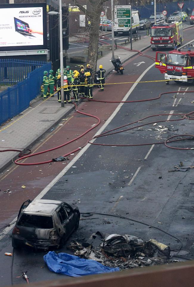 LONDON, ENGLAND - JANUARY 16:  Emergency services at the scene after a helicopter reportedly collided with a crane attached to St Georges Wharf Tower in Vauxhall, on January 16, 2013 in London, England. According to reports, the helicopter hit the crane before plunging into the road below during the morning rush hour.  (Photo by Oli Scarff/Getty Images)