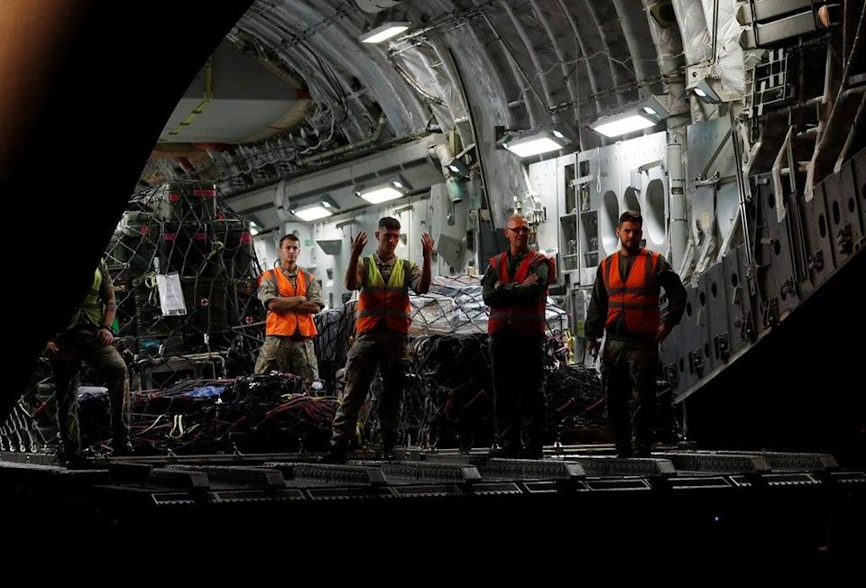 British military personnel prepare to remove cargo from a C-17 aircraft at RAF Brize Norton (Peter Nicholls/PA) (PA Wire)