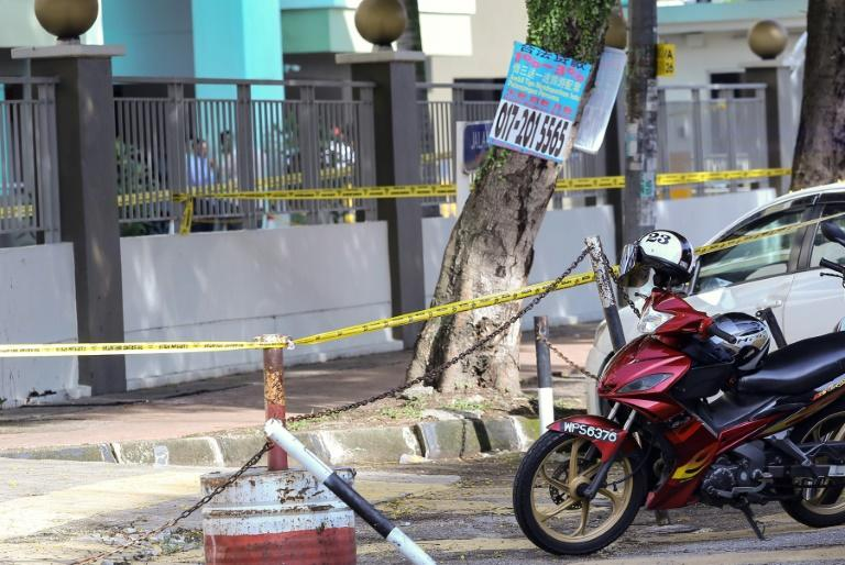 Malaysian forensic police cordon off the area where a Palestinian scientist and Hamas member, Fadi Mohammad al-Batsch, was assassinated in Kuala Lumpur on April 21, 2018