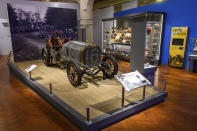 """This image provided by the The Henry Ford, shows a display with the """"Old 16"""" car from the 1908 Vanderbilt Cup race, part of the Driven To Win exhibit at the The Henry Ford Museum in Dearborn, Mich. (Wes Duenkel/The Henry Ford via AP)"""