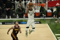 Milwaukee Bucks' Giannis Antetokounmpo shoots past Atlanta Hawks' Danilo Gallinari during the first half of Game 2 of the NBA Eastern Conference basketball finals game Friday, June 25, 2021, in Milwaukee. (AP Photo/Morry Gash)
