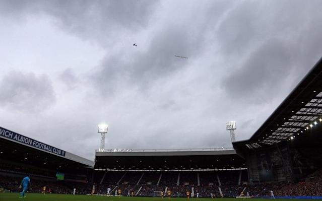 <span>A rival plane supporting Arsene Wenger is flown over the Hawthorns</span> <span>Credit: REX </span>