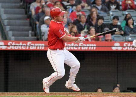 Mar 24, 2019; Anaheim, CA, USA; Los Angeles Angels center fielder Mike Trout (27) follows through on a double in the third inning against the Los Angeles Dodgers at Angel Stadium of Anaheim. Mandatory Credit: Kirby Lee-USA TODAY Sports