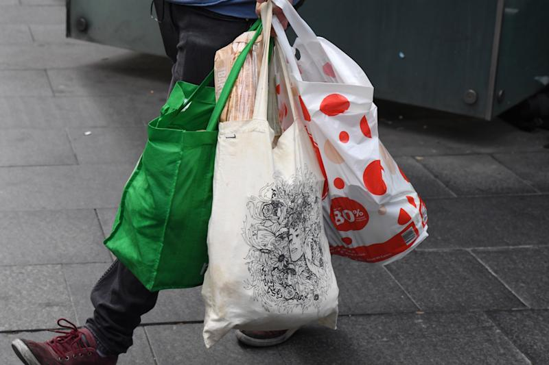 A shopper is seen carrying bags at a Coles Sydney CBD. Source: AAP