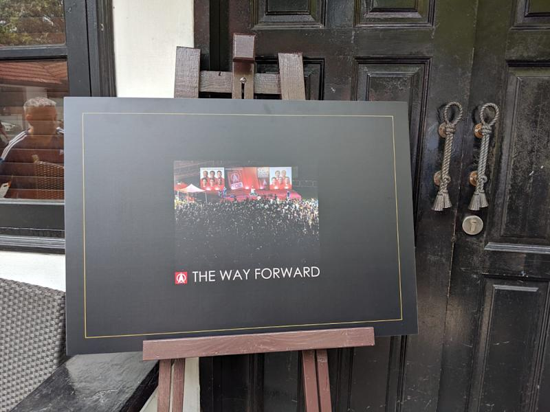 A placard with the design of SDP's coffee-table book 'The Way Forward'. (PHOTO: Wong Casandra/Yahoo News Singapore)