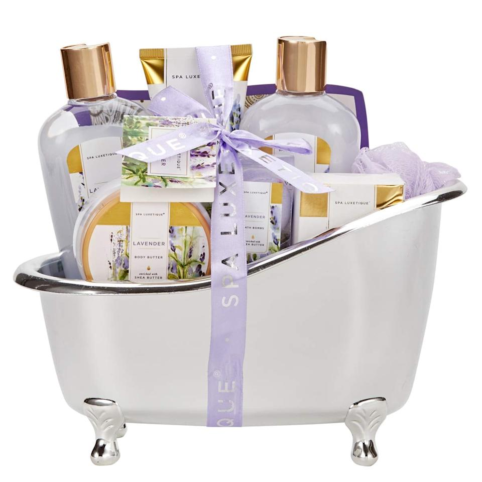 "<p>This <a href=""https://www.popsugar.com/buy/Spa-Luxetique-Bath-Spa-Gift-Set-533548?p_name=Spa%20Luxetique%20Bath%20Spa%20Gift%20Set&retailer=amazon.com&pid=533548&price=28&evar1=bella%3Aus&evar9=44333917&evar98=https%3A%2F%2Fwww.popsugar.com%2Fbeauty%2Fphoto-gallery%2F44333917%2Fimage%2F47031648%2FSpa-Luxetique-Bath-Spa-Gift-Set&list1=gifts%2Camazon%2Cbeauty%20products%2Choliday%2Cgift%20guide%2Cbeauty%20shopping%2Clast-minute%20gifts%2Choliday%20beauty%2Cgifts%20for%20women%2Cgifts%20under%20%2475%2Cbeauty%20gifts&prop13=api&pdata=1"" rel=""nofollow"" data-shoppable-link=""1"" target=""_blank"" class=""ga-track"" data-ga-category=""Related"" data-ga-label=""https://www.amazon.com/Luxetique-Lavender-Fragrance-Luxurious-Baskets/dp/B07C5RX1GR/ref=sr_1_34?keywords=gifts&amp;qid=1576689358&amp;s=beauty&amp;sr=1-34"" data-ga-action=""In-Line Links"">Spa Luxetique Bath Spa Gift Set</a> ($28) comes in the cutest packaging.</p>"
