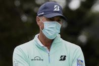 Matt Kuchar wears a face mask while talking at the driving range during practice for the PGA Championship golf tournament at TPC Harding Park Wednesday, Aug. 5, 2020, in San Francisco. (AP Photo/Charlie Riedel)