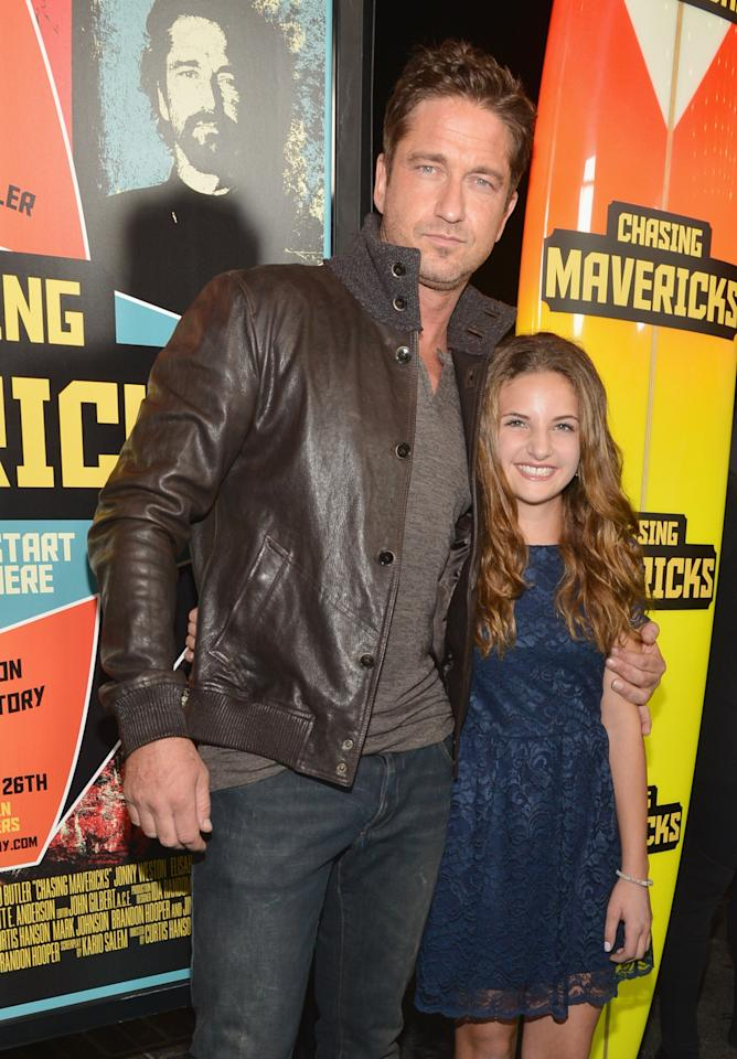 """LOS ANGELES, CA - OCTOBER 18:  Actors Gerard Butler and Maya Raines arrive to the premiere of 20th Century Fox's """"Chasing Mavericks"""" on October 18, 2012 in Los Angeles, California.  (Photo by Alberto E. Rodriguez/Getty Images)"""